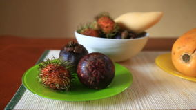 Exotic tropical fruit on table. Thai fruit. close-up.  stock footage