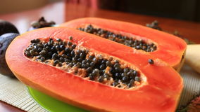 Exotic tropical fruit on table. Thai fruit. Papaya fruit cut in half. close-up. Exotic tropical fruit on table. Papaya fruit cut in half. close-up stock footage