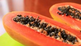 Exotic tropical fruit on table. Thai fruit. Papaya fruit cut in half. close-up.  stock video