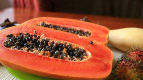 Exotic tropical fruit on table. Thai fruit. Papaya fruit cut in half. close-up.  stock video footage