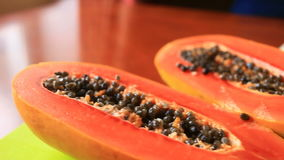 Exotic tropical fruit on table. Thai fruit. Papaya fruit cut in half. close-up.  stock footage