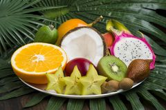 Exotic fruits plate stock images