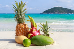 Exotic tropical fruits on the sandy beach. Similan islands Royalty Free Stock Image