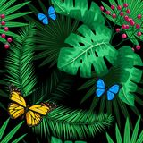 Exotic tropical nature environment repeating pattern background. Seamless repeating jungle rainforest summer green plants, butterfly and fern background Stock Photo