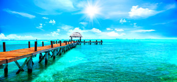 Exotic tropical resort. Jetty near Cancun, Mexico. Travel and vacations concept. Exotic tropical resort. Jetty near Cancun, Mexico. Travel, Tourism and Vacations stock photos
