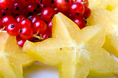 Exotic tropical star fruit and red currant berry stock photos