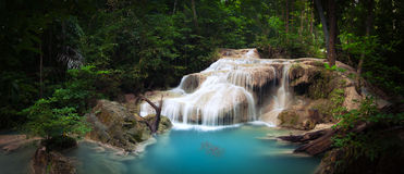 Exotic tropical waterfall in green jungle forest Royalty Free Stock Photography