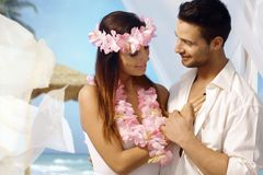 Exotic wedding and honeymoon. Loving couple having exotic wedding on tropical island Royalty Free Stock Image
