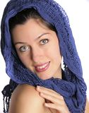 Exotic woman in blue scarf. Blue scarf covers a beautiful woman head Royalty Free Stock Photography