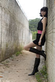 Exotic Young Model. An 18 year old exotic brazilian model, with short dark hair, a young looking face and a skinny body. She is wearing a black dress and pink Stock Images