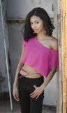 Exotic young woman. Beautiful exotic young woman smiling wearing pink top Stock Images