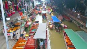 Exotische het drijven van Damnoen Saduak markt, Thailand stock footage