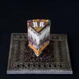 Exotisk kaka med tre sorter av mousse royaltyfri fotografi