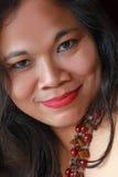 Exotiskt asiatiskt le för kvinna Arkivfoto