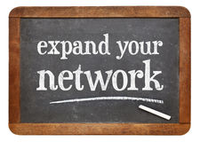 Expand your network advice on slate blackboard Royalty Free Stock Image