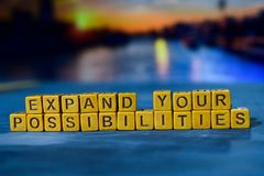 Expand your possibilites on wooden blocks. Cross processed image with bokeh background stock photos