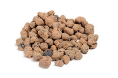 Expanded Clay Aggregate (Grow Rocks). A pile of expanded clay aggregate on white background Royalty Free Stock Image