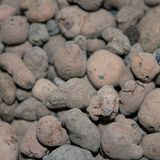 Expanded clay aggregate texture closeup. Expanded clay aggregate texture, light weight clay material for constructional and agricultural purposes Royalty Free Stock Photo
