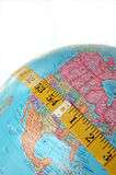 Expanding Nation. Measuring tape stretched across globe. Concept image for weight, nutrition, economy, population, etc Stock Photos
