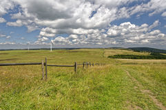 Expanse of a green field with sky behind Royalty Free Stock Images