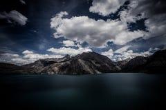 Expanse of Lake Iskander-Kul. Tajikistan. In dark colors Royalty Free Stock Image