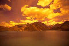 Expanse of Lake Iskander-Kul. Tajikistan. In orange tones Royalty Free Stock Photography