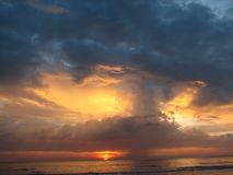 Expanse of the sea against the sunset sky. Royalty Free Stock Image