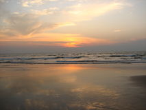 Expanse of the sea against the sunset sky. Royalty Free Stock Photo