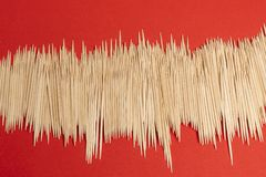 Expanse of toothpicks. An expanse of toothpicks on a red surface royalty free stock image