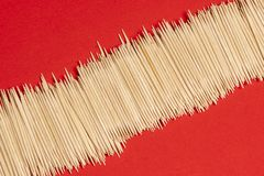 Expanse of toothpicks. An expanse of toothpicks on a red surface royalty free stock photo
