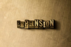EXPANSION - close-up of grungy vintage typeset word on metal backdrop Royalty Free Stock Images