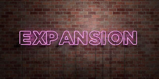 EXPANSION - fluorescent Neon tube Sign on brickwork - Front view - 3D rendered royalty free stock picture Stock Image