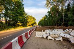 Expansion of the roadway. Repair works on the road stock images