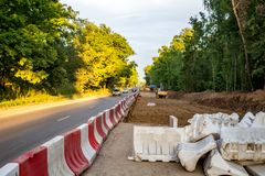 Expansion of the roadway. Repair works on the road royalty free stock photo