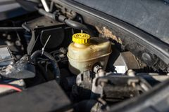 Expansion tank for brake fluid inside the engine compartment. Expansion tank for brake fluid inside the engine compartment stock photos