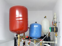 Expansion tanks. Group of expansion tanks in house boiler room Stock Images