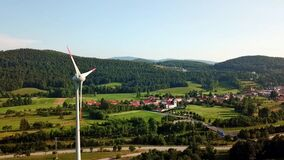 Flight over a wind turbine in a rural area