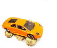 Expansive dream car. Expansive car on coins. Save money for car Royalty Free Stock Photo
