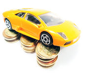 Expansive dream car. Expansive car on coins. Save money for car Stock Photography