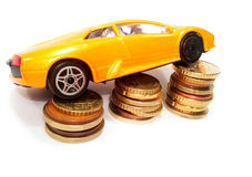 Expansive dream car. Expansive car on coins. Save money for car Stock Photo