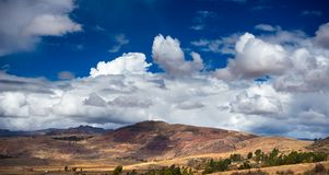 Expansive view of the Sacred Valley, Peru from Pisac Inca site, major travel destination in Cusco region, Peru. Dramatic sky. Stock Photography