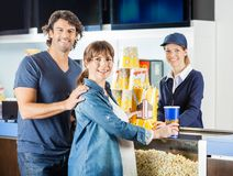 Expectant Couple Buying Snacks From Seller At Royalty Free Stock Photography