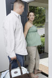Expectant Couple Exiting Home stock image