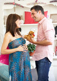 Expectant couple out shopping. Having fun royalty free stock image