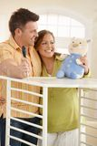 Expectant couple smiling at toy Royalty Free Stock Images