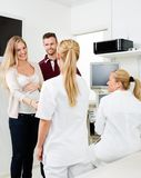 Expectant Couple Visiting Gynecologist Royalty Free Stock Image