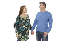 Expectant couple walking hand in hand Stock Image