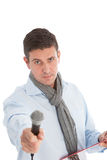 Expectant man holding out a microphone Stock Images