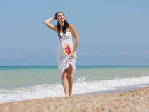Expectant mother on the beach Stock Photography