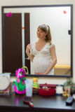 Expectant mother. Pregnant woman admiring herself in the mirror Stock Image